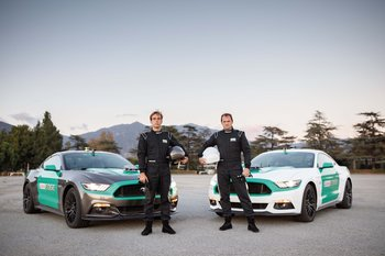 castrol-virtual-racers-matt-powers-l-and-ben-collins-r-pose-in-front-of-their-ford-mustangs