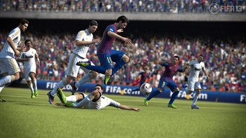fifa13_messi_avoids_tackle_wm