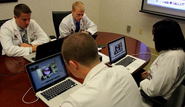 Medical students watch an ACL surgery live