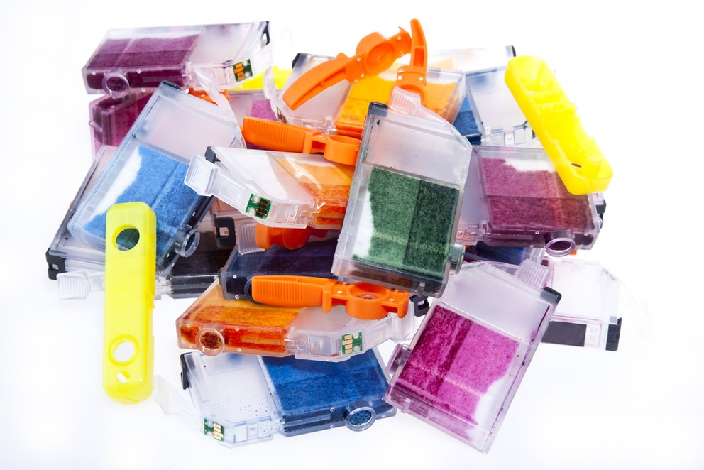 Colorful pile of inkjet printer ink cartridges