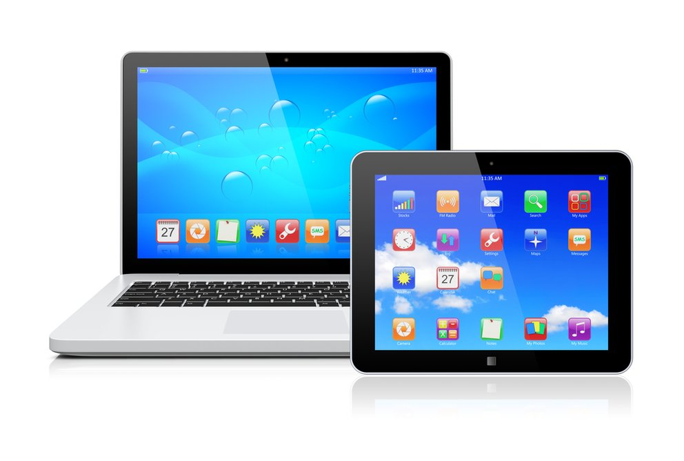 Laptop and tablet pc computer with a blue background