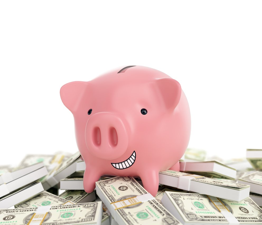 Smiling piggy bank standing on a pile of money