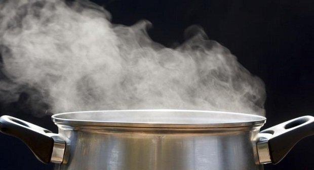 steam on pot in kitchen