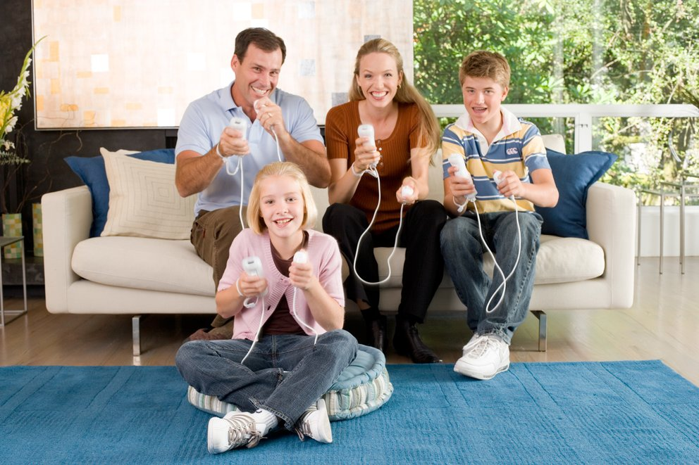 Family-Playing-Nintendo-Wii-and-Wii-U