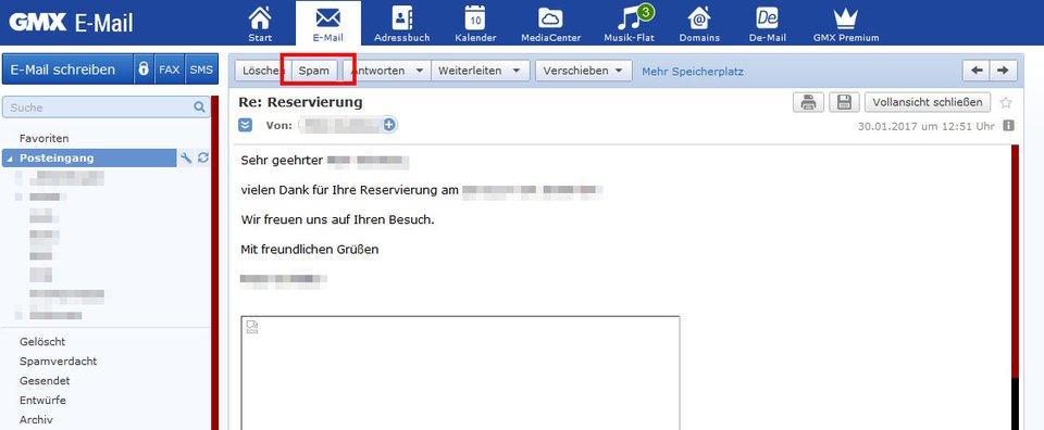 GMX: Klickt hier, um die E-Mail als Spam zu markieren.