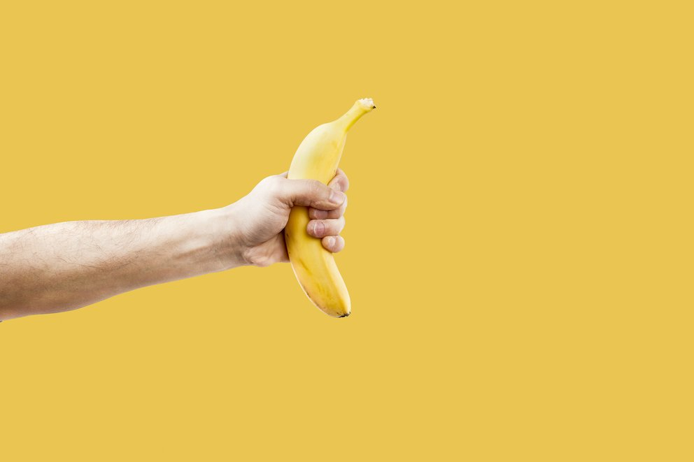 Hand male holding a shape banana telephone.