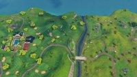 Fortnite: Suche zwischen einer überdachten Brücke und dem 9. Green (Woche 10, Season 5)